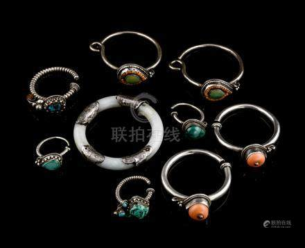 A GROUP OF EIGHT EARRINGS INLAID WITH CORAL AND TURQUOISE AND A JADE BANGLE, China, Kumbum/Eastern T