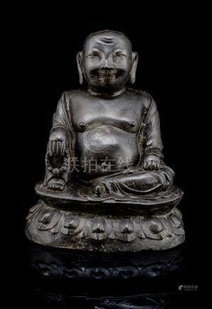 A BRONZE FIGURE OF HVA SHANG, CHINA, early Qing dynasty, seated in rajalilasana on a lotus base with