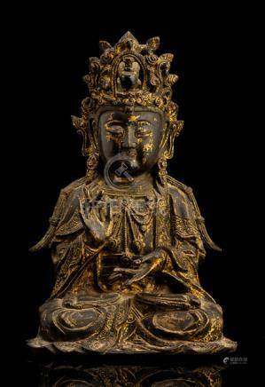 A BRONZE FIGURE OF SEATED GUANYIN WITH REMNANTS OF LACQUER GILDING, China, late Ming dynasty, seated