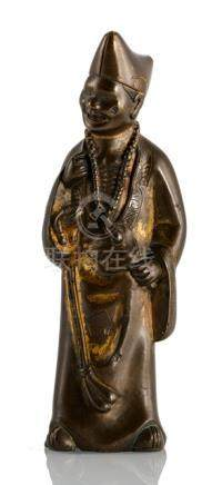 A BRONZE FIGURE OF CHAN BUDDHIST MONK DAOJI, CHINA, 17th ct., standing with his body slightly turned