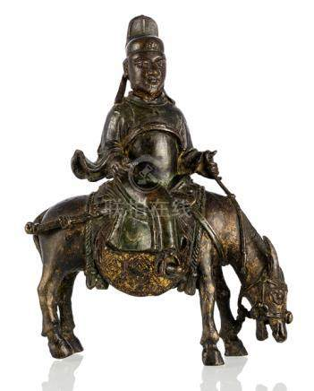 A BRONZE FIGURE OF A DAOIST RIDING A DONKEY, CHINA, 18th ct., riding the buffalo, the latter with hi