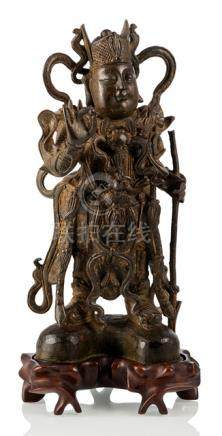 A GILT-LACQUERED BRONZE FIGURE OF STANDING SKANDA, China, 17th ct, wood stand - Property from a Euro