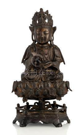 A BRONZE FIGURE OF GUANYIN ON A LOTUS BASE, China, 17th ct. With remnants of gilding. - Formerly pro