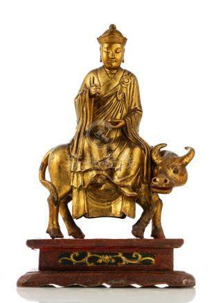 A LACQUERED AND GILT-WOOD FIGURE OF A PRIEST RIDING AN OX, China, ca. 18th ct. - Property from a Eur