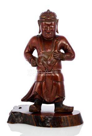 A CARVED AND LACQUERED WOOD FIGURE OF A STANDING BOY WEARING AN ARMOR, China, ca. 17th ct. - Propert