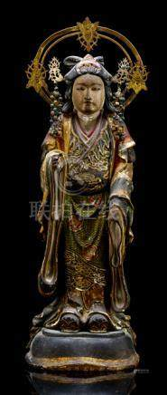 A POLYCHROME PAINTED WOOD SCULPTURE OF KANNON, Japan, 19th Ct. , standing on a plinth, wearing a rob