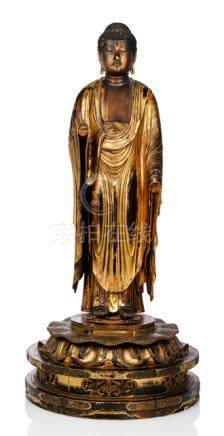 A GILT- AND BLACK LACQUERED WOOD SCULPTURE OF BUDDHA AMIDA, Japan, Edo period, standing in samabhang