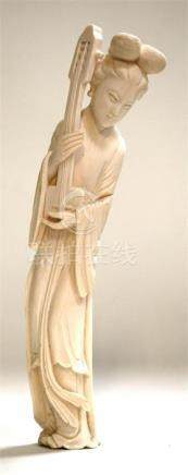 An early 20th century Chinese ivory carving depicting a robed woman holding a musical instrument,