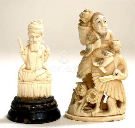 A Japanese Meiji period ivory carving depicting a man seated on the back of a stork, 11cm (4.