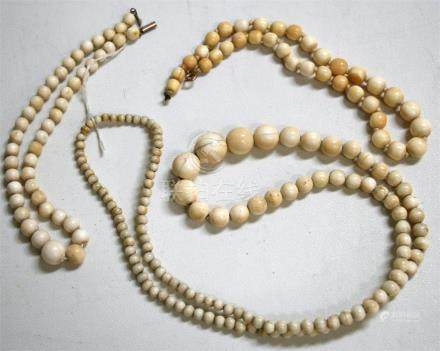 Three early 20th century graduated ivory bead necklaces