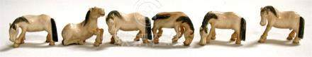 Six early 20th century ivory horses of Mu Wang, each approximately 4cm (1.5ins) long