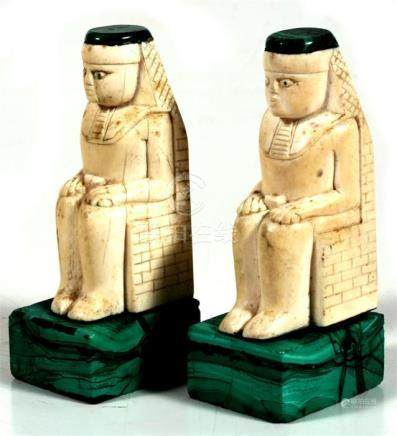 A pair of Egyptian carved bone and malachite figures, 11cm (4.25ins) high