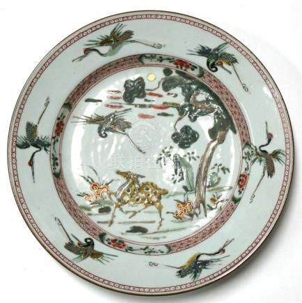 A 19th century Chinese plate, decorated a deer and red headed cranes, 27.5cm (10.75ins) diameter