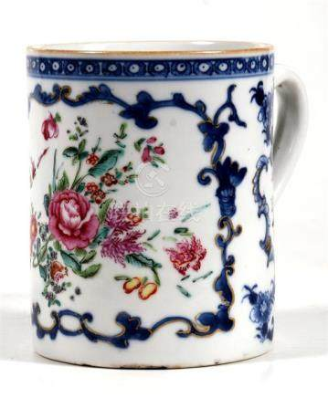 A Chinese porcelain mug, decorated in under glaze blue with foliate panels, 11.5cm (4.5ins) high