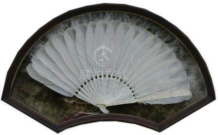 A 19th century Chinese Canton Export ivory feather fan, the guard carved with figures in a