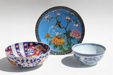 A late 19th century Japanese Meiji period cloisonne charger decorated with a butterfly and flowers