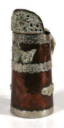A Tibetian copper and white metal mounted jug, decorated dragons 18.5cm (7.25ins) high