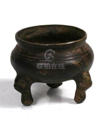 A Chinese bronze three legged censer, 6cm (2.25ins) high