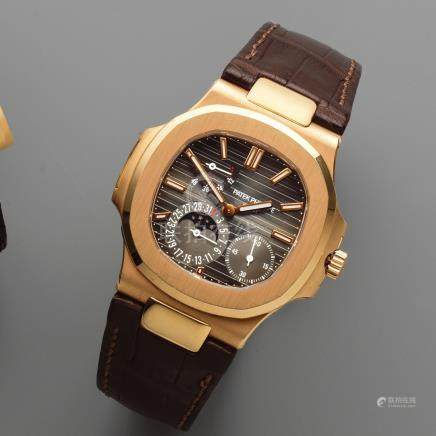 Patek Philippe. A fine and rare 18K rose gold automatic calendar wristwatch with moon phase and power reserve  Nautilus, Ref: 5712, Sold 11th December 2007