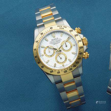 Rolex. A stainless steel and gold automatic chronograph bracelet watch  Cosmograph Daytona, Ref: 116523, Sold 11th July 2013