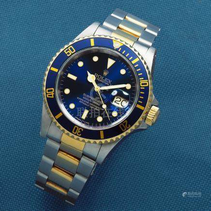 Rolex. A stainless steel and gold automatic calendar bracelet watch  Submariner, Ref: 16613, Circa 1991