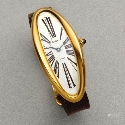 Cartier. A rare oversized 18K gold manual wind oval wristwatch  Baignoire Oval Maxi, London Hallmark for 1969