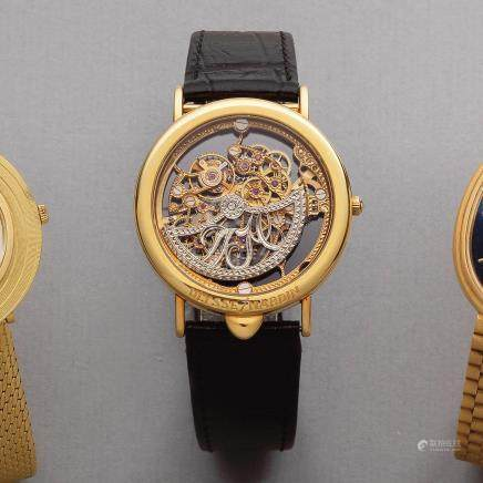 Ulysse Nardin. An unusual 18K gold inverted automatic skeletonised wristwatch Ref: 141 28, Circa 1990