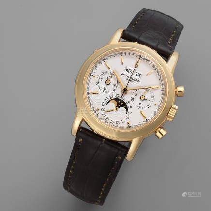 Patek Philippe. A fine 18K gold manual wind perpetual calendar chronograph wristwatch with moon phase Ref: 3970, Sold 16th February 1996