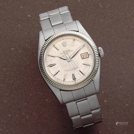 Rolex. A rare and early stainless steel and 18k white gold automatic calendar bracelet watch with roulette date wheel and red Datejust  Datejust, Ref: 6305/2, Circa 1956