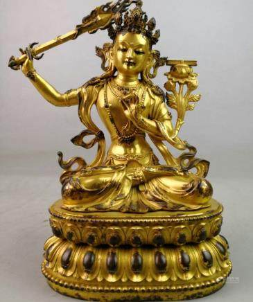 18 C.,A Gilt Bronze Buddha Statue