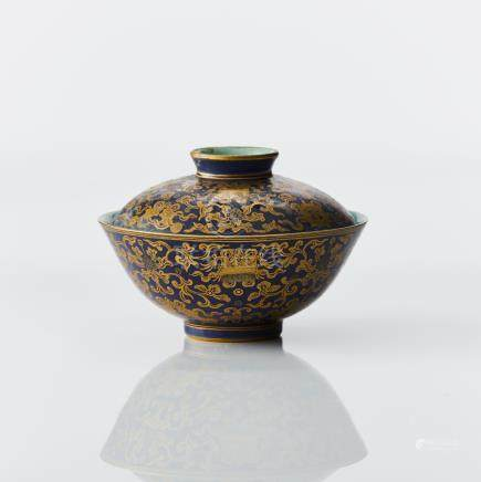 A blue ground gilt bowl and cover