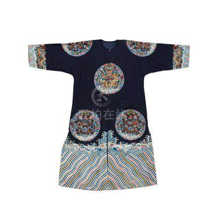 A midnight-blue-ground embroidered surcoat, gunfu