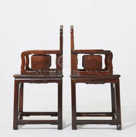 A pair of Chinese carved chairs