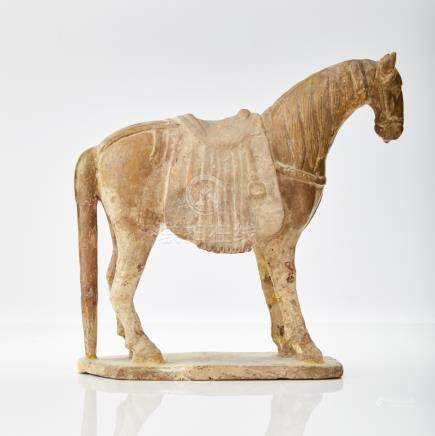 A rare standing figure of an early Tang horse