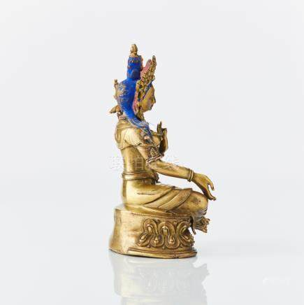 An East Tibetan or Mongolian gilt bronze figure of Green Tara