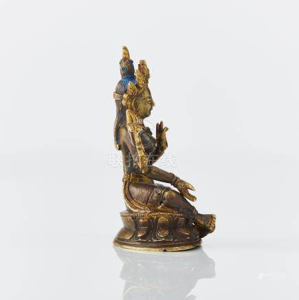 A parcel gilt Tibeto-Chinese figure of Green Tara