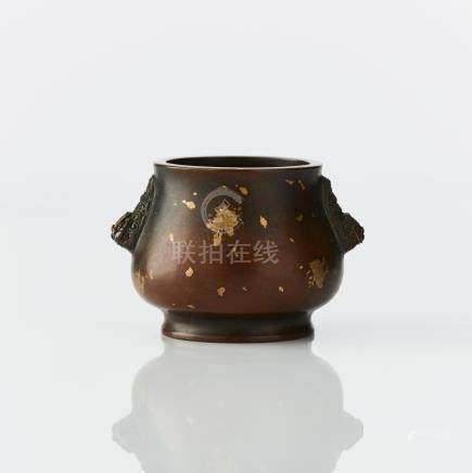 A gilt splashed bronze censer