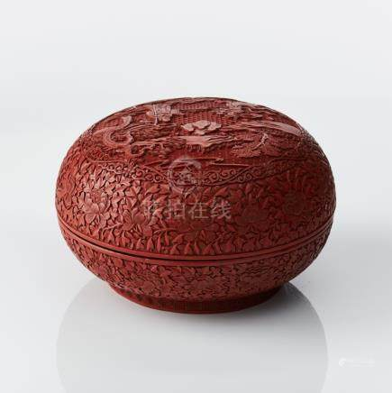 A carved cinnabar lacquer box and cover
