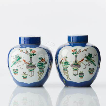 A pair of Chinese vases and covers