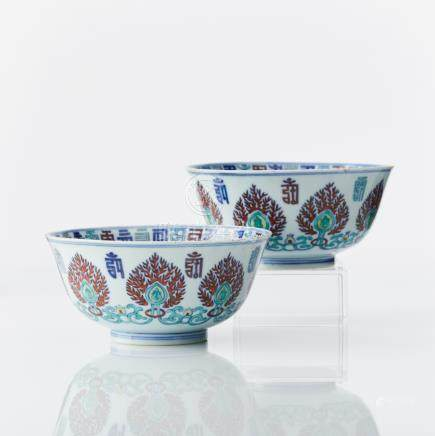A rare pair of doucai bowls