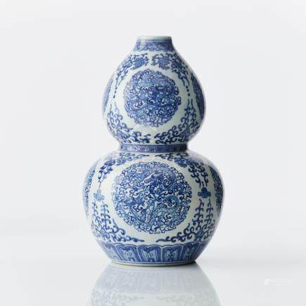 A Chinese blue and white double gourd vase