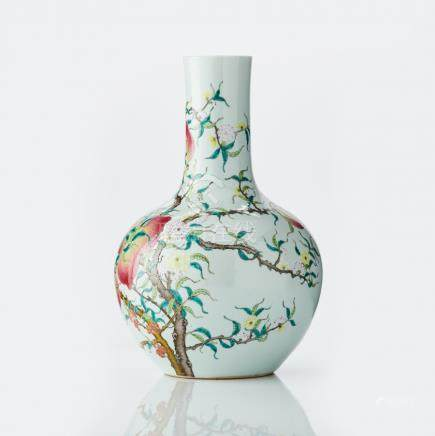 A Chinese famille rose 'peach' bottle vase