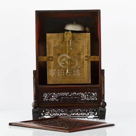 A Chinese wood mantel clock