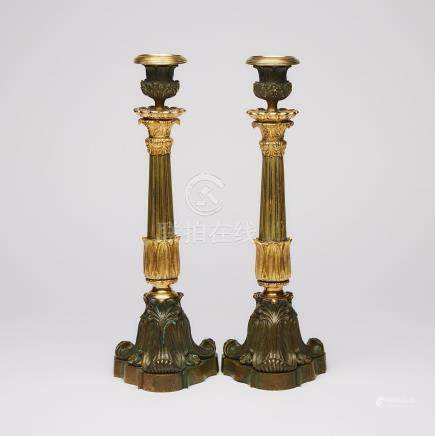 Pair of French Empire Gilt and Patinated Bronze Candlesticks, mid 19th century