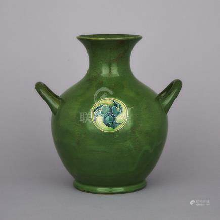 Moorcroft Green Flamminian Two-Handled Vase, c.1906-13, height 10\ — 25.5 cm.