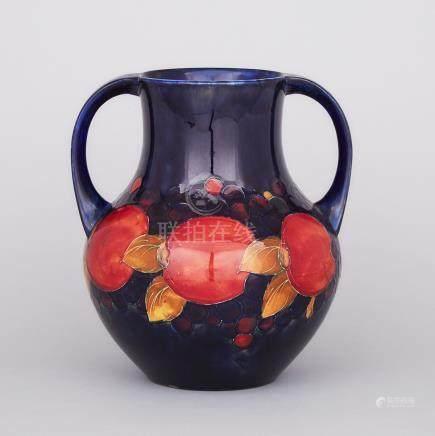 Large Moorcroft Two-Handled Pomegranate Vase, c.1925, height 10.6\ — 27 cm.