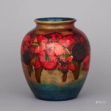 Moorcroft Flambé Orchids Vase, dated 1951, height 10.2\ — 26 cm.