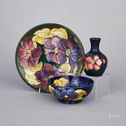 Moorcroft Clematis Bowl, Plate and Small Vase, c.1955-75, plate diameter 10.2\ — 26 cm. (3 Pieces)