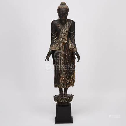 A Standing Black Lacquer Wood Buddha, Mandalay Period, Burma, 19th Century