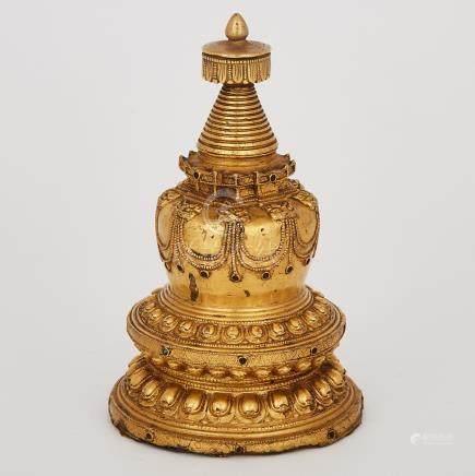 A Tibetan Gilt Bronze Stupa